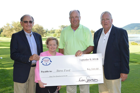 2016 Otesaga Hotel Seniors Open champion Steve Ford of Melbourne, Fla. (center) poses with his winner's check alongside (from left) Daryl Forsythe, former chairman of NBT Bank; Anya Eriksen, a resident and employee of Pathfinder Village; and Dan Spooner, director of golf at Leatherstocking Golf Course. (Lori Grace / Pathfinder Village)