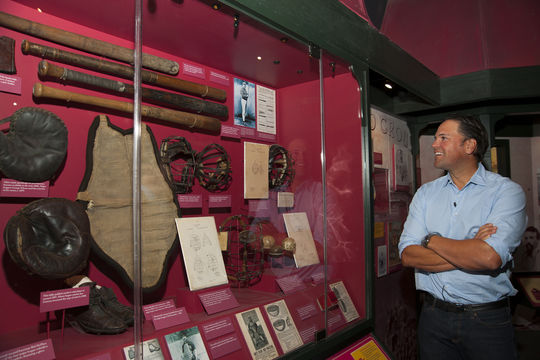 Class of 2016 electee Mike Piazza looks at some of the earliest pieces of catcher's equipment in the Museum's 19th Century Room during his Hall of Fame Orientation Visit on March 8, 2016. (Milo Stewart, Jr. / National Baseball Hall of Fame)