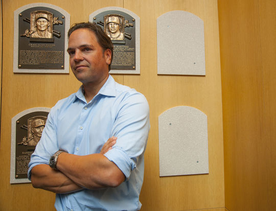 Class of 2016 electee Mike Piazza stands next to the spot where his Hall of Fame plaque will hang during his Orientation Visit on March 8, 2016. Piazza and Ken Griffey Jr. will be inducted to the Hall on July 24. (Milo Stewart, Jr. / National Baseball Hall of Fame)