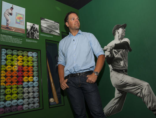 Class of 2016 electee Mike Piazza stands next to the popular Ted Williams heat map display on the Museum's second floor during his Hall of Fame Orientation Visit on March 8. (Milo Stewart, Jr. / National Baseball Hall of Fame)