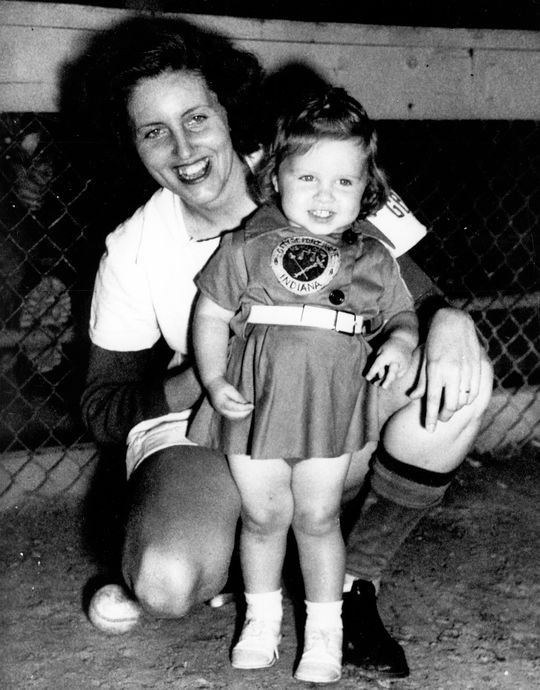 """A photograph taken in 1950 of Dottie Collins and her daughter, Patty (19 months), dressed in matching Fort Wayne Daisies uniforms.  <a href""""http://collection.baseballhall.org/islandora/object/islandora%3A503804"""">PASTIME</a> (National Baseball Hall of Fame and Museum)"""