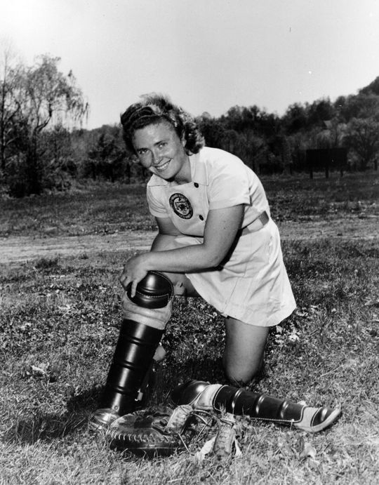 "Lavonn ""Pepper"" Paire Davis putting on her catching equipment. BL-3387.98 (National Baseball Hall of Fame Library)"