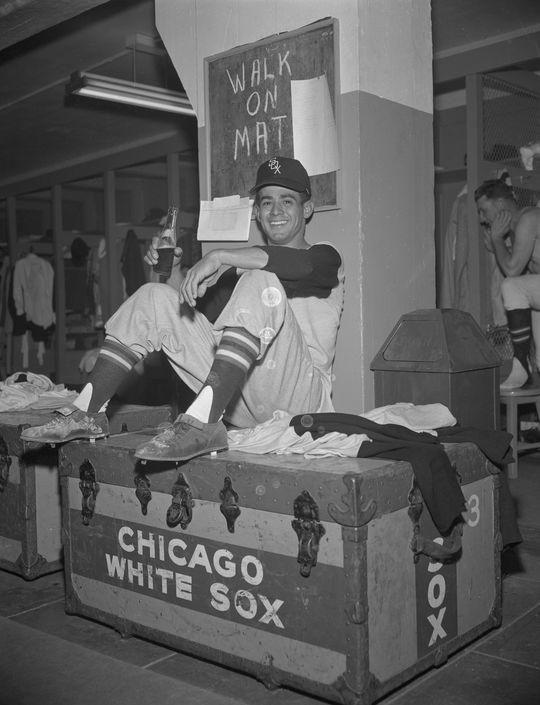 Luis Aparicio sitting on top of a Chicago White Sox trunk. (Osvaldo Salas Collection / National Baseball Hall of Fame Library)