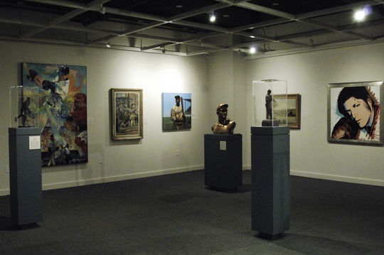 "A view of the ""Art of Baseball"" exhibit.  The Christy Mathewson bust can be seen in the center of the photograph while the Tom Seaver painting is on the far right. (Milo Stewart, Jr. / National Baseball Hall of Fame)"