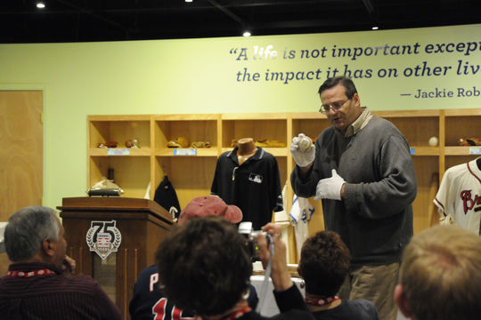 Bruce Markusen, the Museum's manager of digital and outreach learning, presents an Artifact Spotlight to VIP Experience guests in the Museum's Learning Center. The VIP Experience gives visitors a look at behind-the-scenes treasures at the Museum. (Milo Stewart, Jr. / National Baseball Hall of Fame)