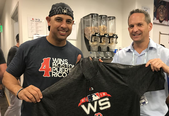 Red Sox manager Alex Cora presents Hall of Fame President Jeff Idelson with his hoodie from the World Series following Boston's win to wrap up the Fall Classic on Oct. 28. (National Baseball Hall of Fame and Museum)