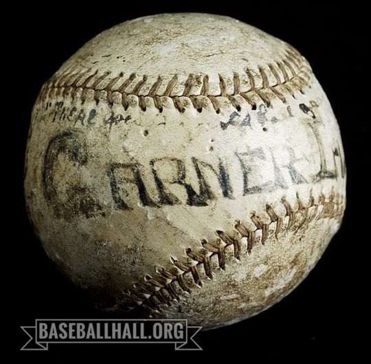 """<a href=""""https://collection.baseballhall.org/PASTIME/amanda-clement-baseball-1908-august-18-20-0"""">This baseball</a> was used in series of games umpired by Amanda Clement from Aug. 18-20, 1908 in Garner, Iowa. The ball is inscribed with the date and location, as well as additional text explaining the significance of having a woman umpire officiate the series. (Milo Stewart Jr./National Baseball Hall of Fame and Museum)"""