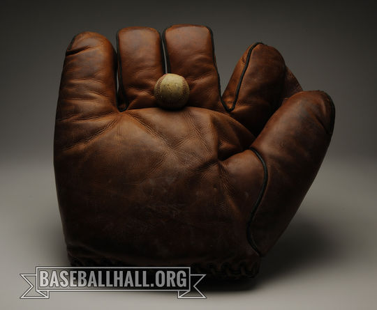 """Nick Altrock and Al Schacht often used gag equipment at games, like this oversized glove now preserved in the Hall of Fame's collection. < a href=""""https://collection.baseballhall.org/PASTIME/nick-altrock-oversized-glove-undated-0"""">PASTIME</a> (Milo Stewart Jr./National Baseball Hall of Fame and Museum)"""