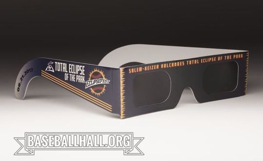 """The Salem-Keizer Volcanoes gave away <a href=""""https://collection.baseballhall.org/PASTIME/salem-volcanoes-eclipse-game-glasses-2017-august-21-0"""">solar eclipse glasses</a> to fans and players during the Aug. 21, 2017, 'Eclipsefest' game at Volcanoes Stadium in Keizer, Ore. (Milo Stewart Jr./National Baseball Hall of Fame and Museum)"""