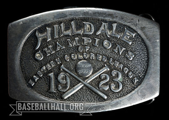 """The Hall of Fame's collection includes a sterling silver belt buckle awarded to the members of the 1923 Hilldale club to celebrate their pennant-winning season in 1923. <a href=""""https://collection.baseballhall.org/PASTIME/hilldale-colored-leagues-champion-belt-buckle-1923-2"""">PASTIME</a> (Milo Stewart Jr./National Baseball Hall of Fame and Museum)"""
