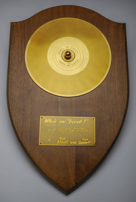 """The gold record Abbott and Costello received for their recording of """"Who's On First"""" hangs in the Museum's Library in Cooperstown. (Milo Stewart Jr./National Baseball Hal of Fame and Museum)"""