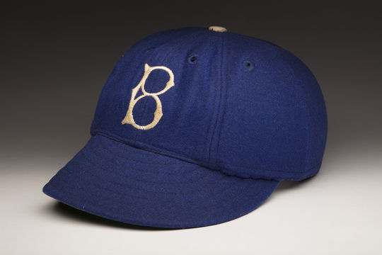 "Hall of Famers Pee Wee Reese and Joe Medwick wore these <a href=""http://collection.baseballhall.org/islandora/object/islandora%3A501159"">""Brooklyn Safety Caps""</a> during Spring Training in 1941, after being hit by pitches the year before. This innovation was seen as an early version of the batting helmet. (Milo Stewart Jr. / National Baseball Hall of Fame)"