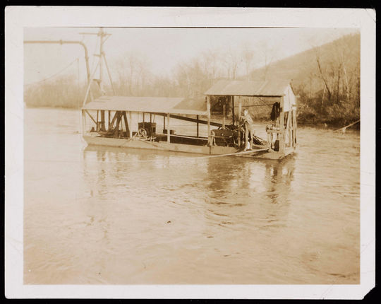 """On the back of this image, someone has typed """"1917 Daubert coal dredge pumping coal from Schuylkill River to aid war effort. Coal shipped to steel mills."""" The person on the dredger is unidentified. BA-SCR-219-2-002.  (National Baseball Hall of Fame and Museum)"""