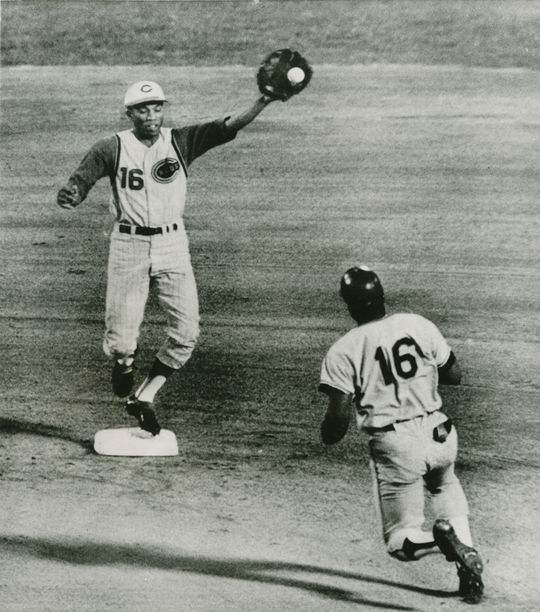 """Shortstop Leo Cardenas, pictured here at Cincinnati's Crosley Field in 1965, had proven his defensive prowess since joining the Reds in 1960. Because of that, shortstop Tommy Helms was shifted to second base, and then third. <a href=""""https://collection.baseballhall.org/PASTIME/leo-cardenas-action-photograph-1965-september-22"""">PASTIME</a>  (National Baseball Hall of Fame and Museum)"""