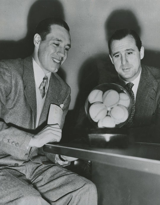 "Bob Feller with Hank Greenberg, general manager of the Cleveland Indians. Both men pose for a photograph after Feller signed his 13th contract with the Indians for $50,000, making him the highest paid pitcher in the American League. <a href=""https://collection.baseballhall.org/islandora/object/islandora%3A610689"">PASTIME</a> (National Baseball Hall of Fame and Museum)"
