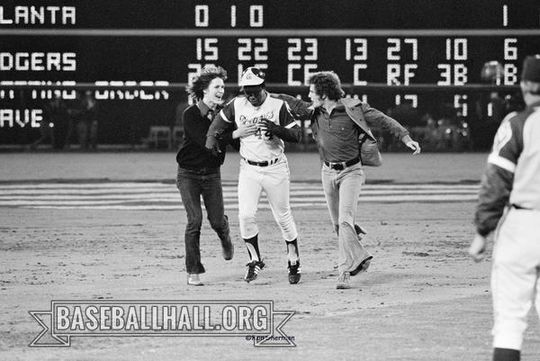 The iconic image of Hank Aaron rounding the bases after home run No. 715 on April 8, 1974, was taken by Ron Sherman. A replication of the image is on display in the Hall of Fame's exhibit dedicated to Aaron's career. (Ron Sherman/National Baseball Hall of Fame and Museum)