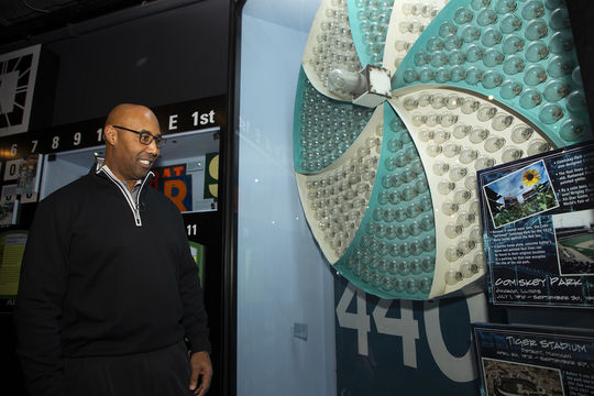 Harold Baines pauses to look at a pinwheel from the Comiskey Park scoreboard that is on display at the Hall of Fame. Baines played 14 of his 22 big league seasons for the Chicago White Sox, who called Comiskey Park home through the 2002 season. (Milo Stewart Jr./National Baseball Hall of Fame and Museum)