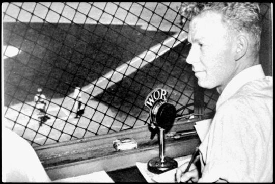 Brooklyn Dodgers broadcaster Red Barber, in an undated photo, sitting behind home plate in the press box. BL-119.2008.10 (Larry Hogan / National Baseball Hall of Fame Library)