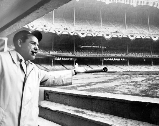 New York Yankees manager Yogi Berra looks out at the field on April 15, 1964 after his managerial debut was rained out. BL-1653-68WT (National Baseball Hall of Fame Library)