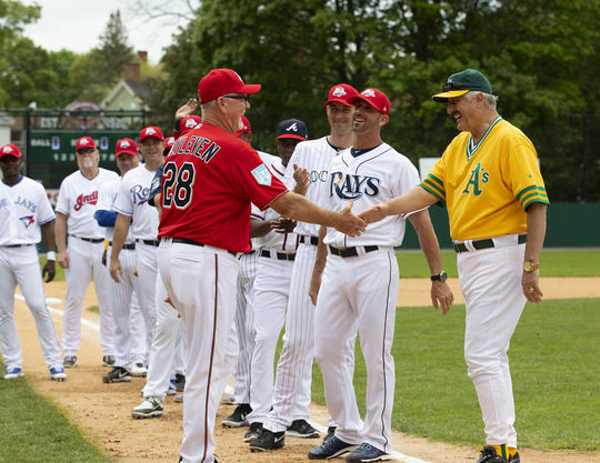 Hall of Famers Bert Blyleven and Rollie Fingers shake hands prior to the start of the 2019 Hall of Fame Classic. (Milo Stewart Jr./National Baseball Hall of Fame and Museum)