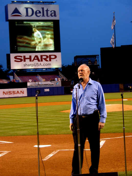 """Terry Cashman performing Tattered Flag in the Breeze (Michael's Song), """"as a tribute to the healing power of baseball, that began with Piazza's massive home run"""" at Shea Stadium in 2002, on the first anniversary of the first game played in NYC after 9/11. BL-204.2011.1 (Laura Fieber-Minogue / National Baseball Hall of Fame Library)"""