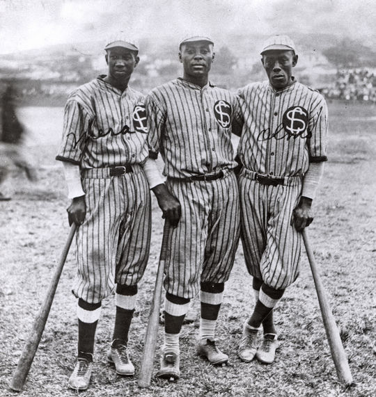 Hall of Fame Outfielder Oscar Charleston, center, was a frequent teammate of Marcelle's.  Here he stands with fellow outfielders Pablo Mesa, left, and Alejandro Oms, right, who comprised the outfield for the legendary 1923-24 Leopardos de Santa Clara. Charleston-Oscar-6550.76_Grp_PD (National Baseball Hall of Fame and Museum)