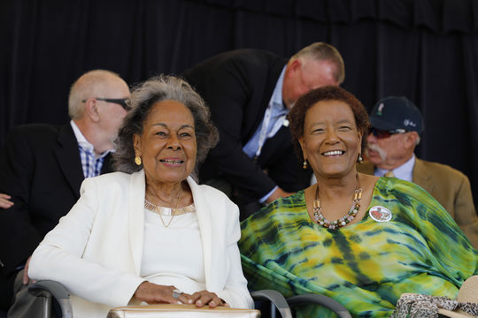 2017 Buck O'Neil Award Winner Rachel Robinson (left) shares a laugh with 2017 J.G. Taylor Spink Award Winner Claire Smith at the 2017 <em>Awards Presentation</em>. (Milo Stewart Jr. / National Baseball Hall of Fame and Museum)