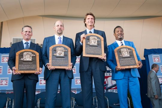 The Hall of Fame Class of 2015 -- Craig Biggio, Randy Johnson, Pedro Martínez and John Smoltz -- hold their new plaques at the Induction Ceremony on July 26, 2015 at the Clark Sports Center in Cooperstown. (Milo Stewart, Jr. / National Baseball Hall of Fame)