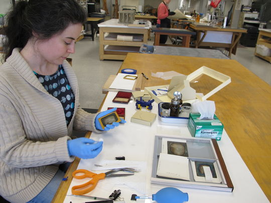 Associate Photograph and Paper Conservator Amanda Maloney prepares to rehouse a daguerreotype plate in the lab at Northeast Document Conservation Center in Andover, Mass. (Photo courtesy of Northeast Document Conservation Center)