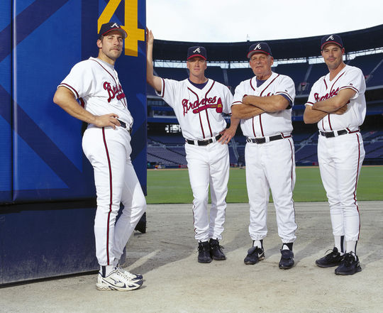 John Schuerholz inherited talent like John Smoltz (far left) and Tom Glavine (middle left) when he joined the Braves in 1990, and manager Bobby Cox (middle right) was already on the scene. But over the next few seasons, Schuerholz brought in players like Greg Maddux (far right) that combined with the talent on hand to make the Braves a perennial contender. (National Baseball Hall of Fame)