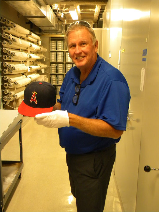 Tommy John holds his Angels cap from May 1, 1984 that he wore when he won his 250th big league game. The cap is now part of the Hall of Fame's collection. (Bill Francis / National Baseball Hall of Fame)