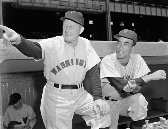 Chuck Dressen, at left, managed Carlos Paula when he was with the Senators in 1955 and 1956.  At the right is Cuban shortstop Jose Valdivielso.  Photo by Osvaldo Salas.  (National Baseball Hall of Fame)