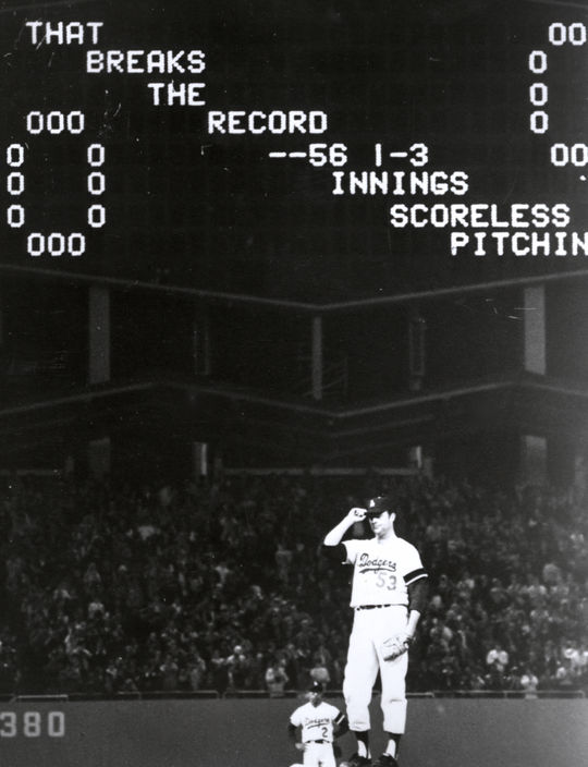 Los Angeles Dodgers pitcher Don Drysdale tips his cap to the crowd at Dodger Stadium after breaking Walter Johnson's all-time record of 56 consecutive scoreless innings. BL-3017-76 (National Baseball Hall of Fame Library)