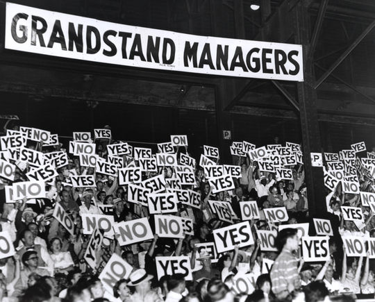 """Grandstand Managers Night"" allowed fans to vote on key decisions during the course of the game, using placards which read ""yes"" or ""no."" (National Baseball Hall of Fame)"