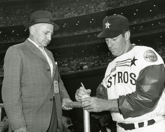 Dick Farrell signing first ball used in the first game in Astrodome for Ken Smith. Exhibition game played vs Yankees, April 9, 1965 - BL-147-65 (National Baseball Hall of Fame Library)