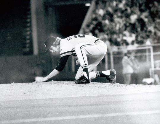 Mark Fidrych manicures the mound before the start of an inning.  Photograph by Bob Bartosz.  Fidrych Mark 2230-2000_FL_Bartosz  (National Baseball Hall of Fame and Museum)