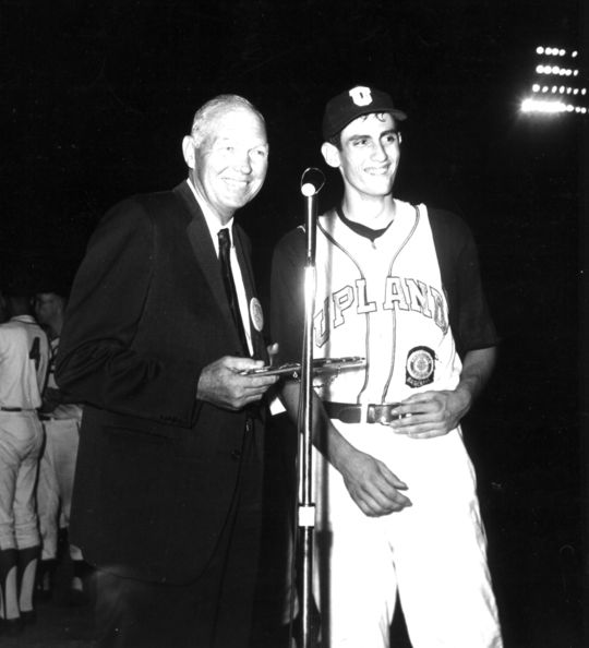 Future Hall of Fame pitcher Rollie Fingers (right) accepts the American Legion's Player of the Year Award from Hall of Famer Bill Dickey in 1964. Many Hall of Famers played in organized youth baseball leagues as youngsters. BL-899-64 (National Baseball Hall of Fame Library)