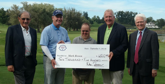 Mark Brown (second from left), the winner of the 36th Annual Otesaga Hotel Seniors Open, receives his winner's check from (center) Pathfinder Village's Eric Mackiewicz and (second from right) Leatherstocking Golf Course PGA pro Dan Spooner on Friday, Sept. 7. At far left is Daryl Forsythe and at far right is Jim Miles, both members of the Seniors Open tournament committee. (Craig Muder/National Baseball Hall of Fame and Museum)