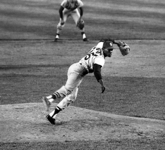 Bob Gibson's explosive fastball helped him win seven of his nine Postseason starts and set a World Series record with 17 strikeouts in Game 1 of the 1968 Fall Classic. (Fred Roe/National Baseball Hall of Fame and Museum)