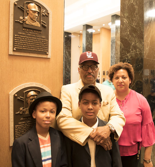 Gilberto Dihigo, his wife Marisol and sons Gilbert and Gregory toured the Hall of Fame Plaque Gallery on June 29. Dihigo's father Martin Dihigo, considered one of the finest players in Negro Leagues history, was elected to the Hall of Fame in 1977. (Milo Stewart Jr./National Baseball Hall of Fame and Museum)