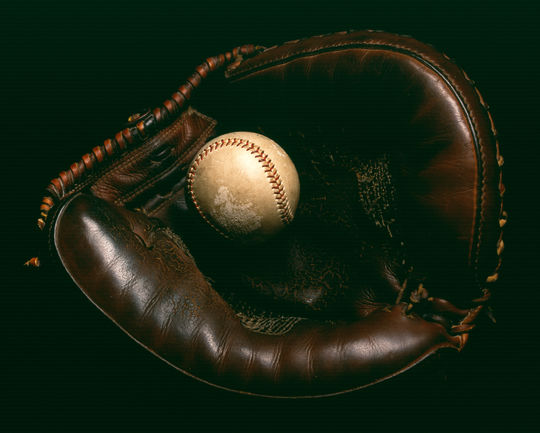 Yogi Berra used this catchers mitt during Don Larsen's World Series perfect game on Oct. 8, 1956. The ball pictured was also used during that game and is also a part of the Museum's collection. (By Photographer Milo Stewart Jr./National Baseball Hall of Fame and Museum)