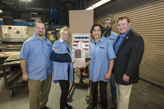 From left, Matthews Architectural Products plant manager Greg Geers, sculptors Mindy Ellis and Tom Tsuchiya, finishing specialist Doug Wood and director of sales and marketing Josh Rooney pose with a plaque mold for 2015 Hall of Fame inductee Randy Johnson. Tsuchiya is taking over as the new sculptor of Hall of Fame plaques for Ellis, who created 76 sculpted likenesses for the Cooperstown shrine. (Courtesy of Matthews Architectural Products)