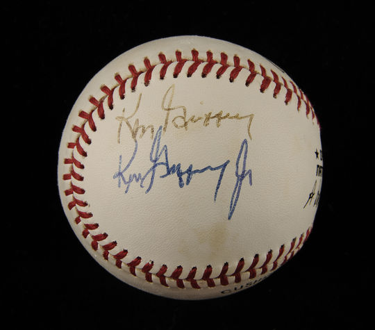This baseball, signed by both Ken Griffey Jr. and Sr. after their first game as teammates, is now preserved in the National Baseball Hall of Fame's collection. (Milo Stewart Jr. / National Baseball Hall of Fame)