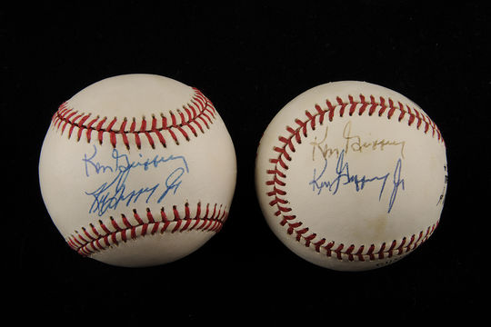 Two baseballs, each signed by Ken Griffey Jr. and Sr., who became the first father-son duo to be MLB teammates in 1990. (Milo Stewart Jr. / National Baseball Hall of Fame)