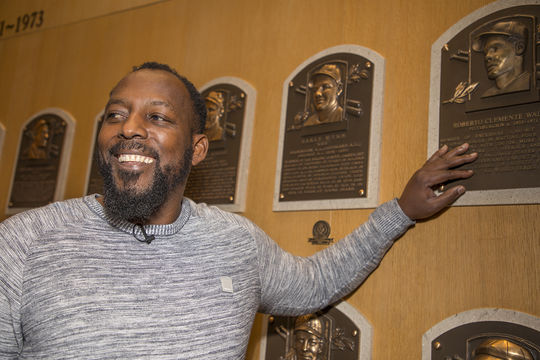 Vladimir Guerrero motions toward Roberto Clemente's plaque during his tour of the Hall of Fame. (Milo Stewart Jr./National Baseball Hall of Fame and Museum)
