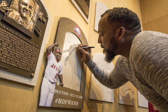 Vladimir Guerrero signs the backer where his plaque will be placed during his Orientation Visit to the Hall of Fame. (Milo Stewart Jr./National Baseball Hall of Fame and Museum)