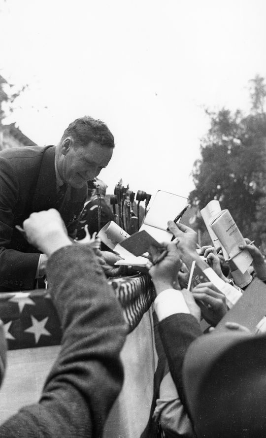 Walter Johnson (pictured above) signs autographs during the first Hall of Fame Induction Ceremony in 1939. (National Baseball Hall of Fame)