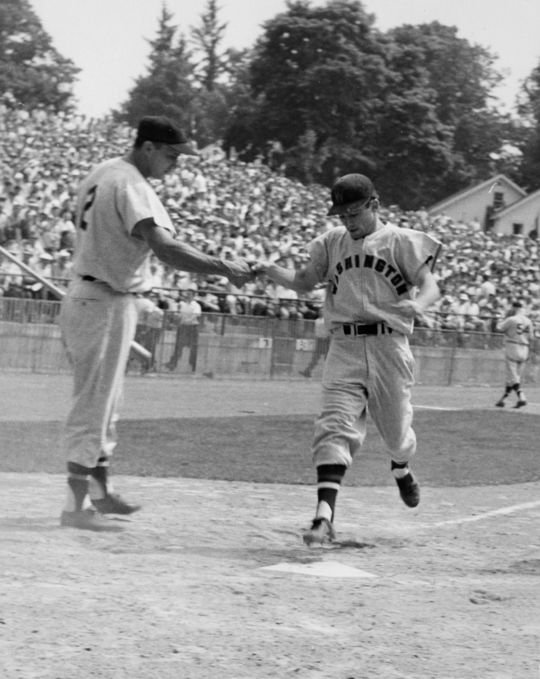 Outfielder Roy Sievers congratulates Albie Pearson as he crosses home plate. (Wyer)