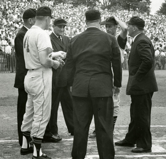 A meeting at home plate before the start of the 1959 Hall of Fame Game. BL-525.2012.25 (National Baseball Hall of Fame Library)