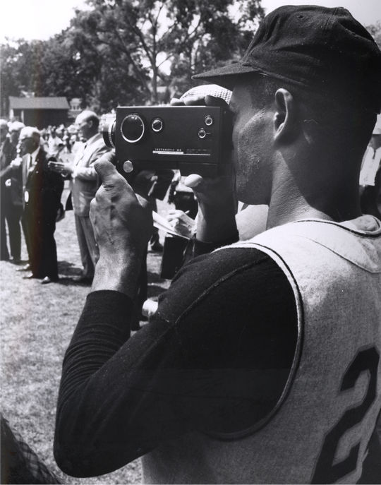 Roberto Clemente capturing the action through the lens of a camera. (National Baseball Hall of Fame)
